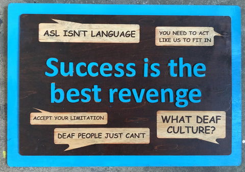 "Wooden sign with engraved conversations putting down ASL or Deaf culture with quote, ""Success is the Best Revenge"""