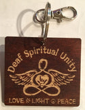 "Wooden key chains with engraved ""Deaf Spiritual Unity"" with logo and words, ""Love Light Peace"" at the bottom"