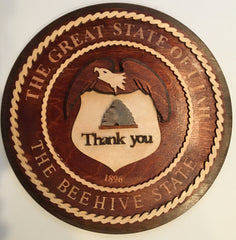 "Image of Circular Wooden Sign with Eagle and Bee Hive Logo from Utah with ""Thank You"""
