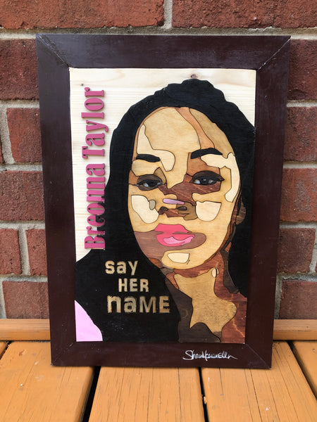 "Woodcut of Breonna Taylor with a woodcut printed of her name along with engraved, ""Say Her Name"""