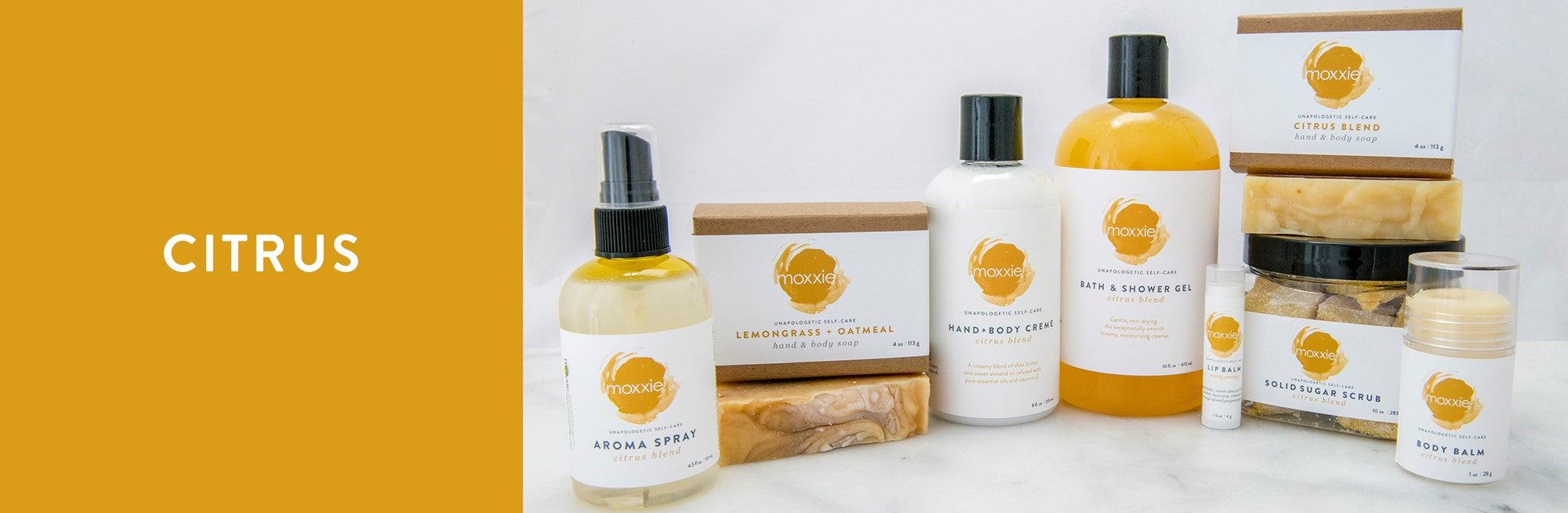 MOXXIE Citrus collection of handcrafted bath and body natural soaps, hand and body cremes, solid lotion body balms, solid sugar scrub cube and aroma sprayss,