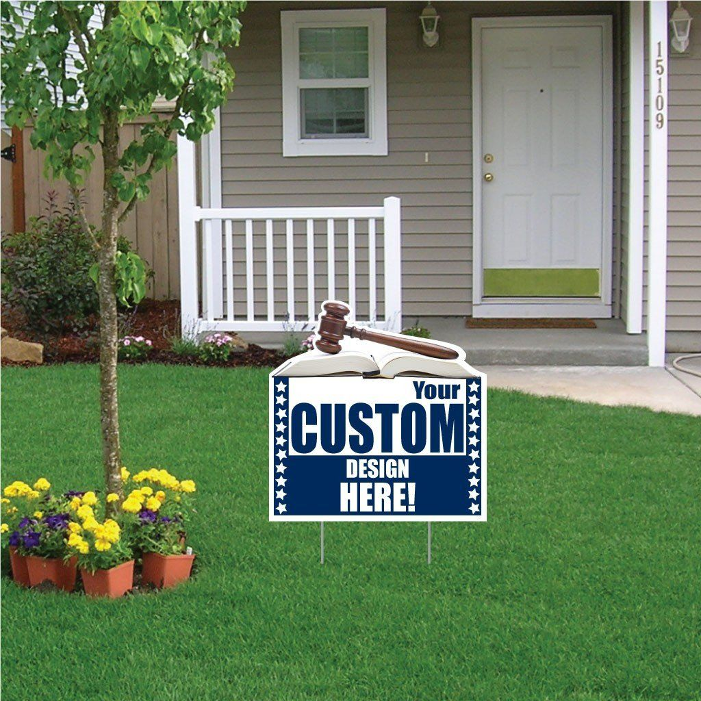 The front yard of a house with a custom printed yard sign