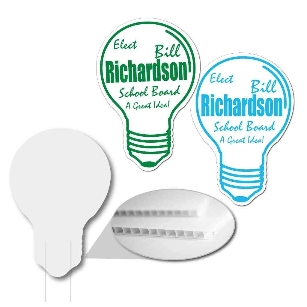 two light bulb shaped yard signs