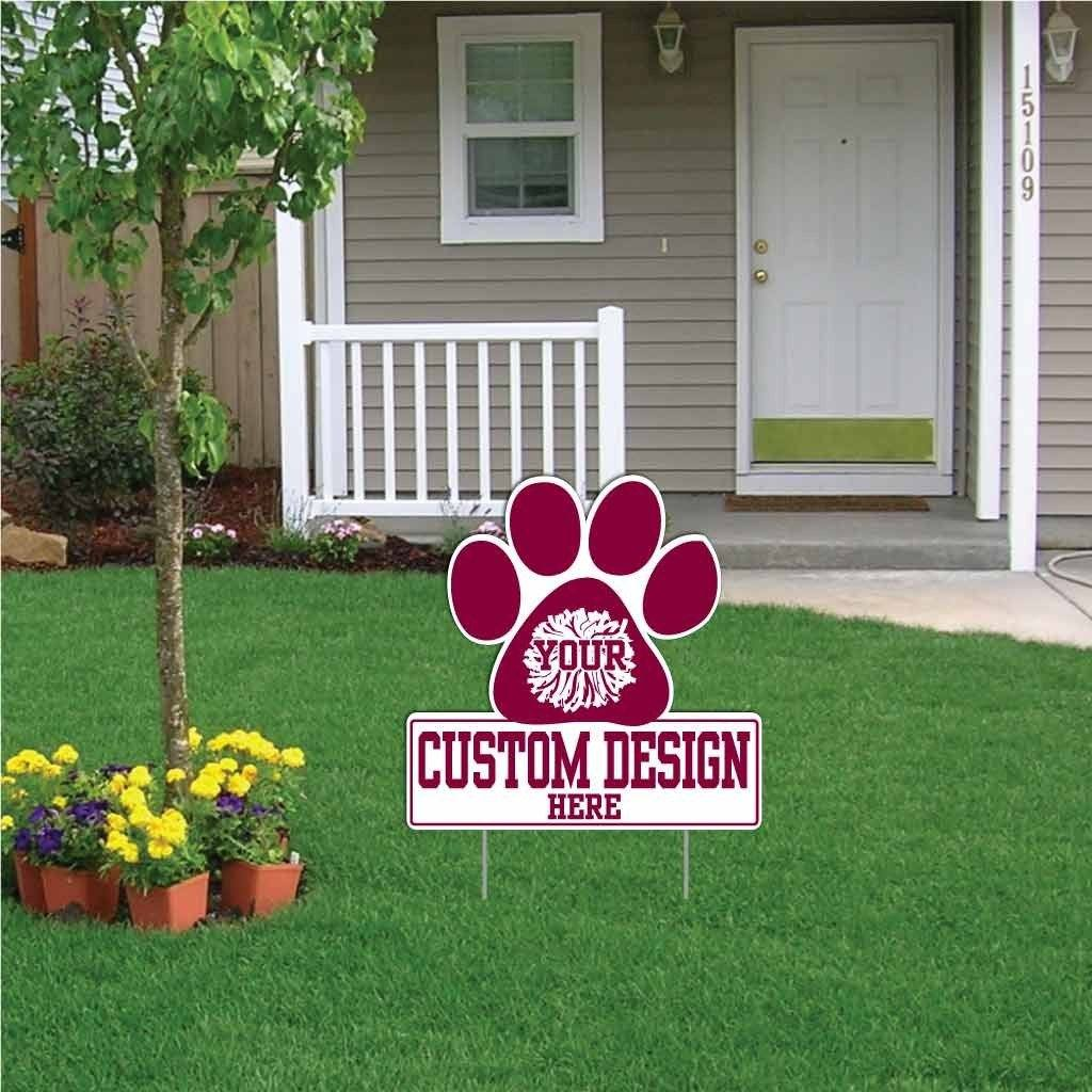 The front yard of a house with a animal paw shape