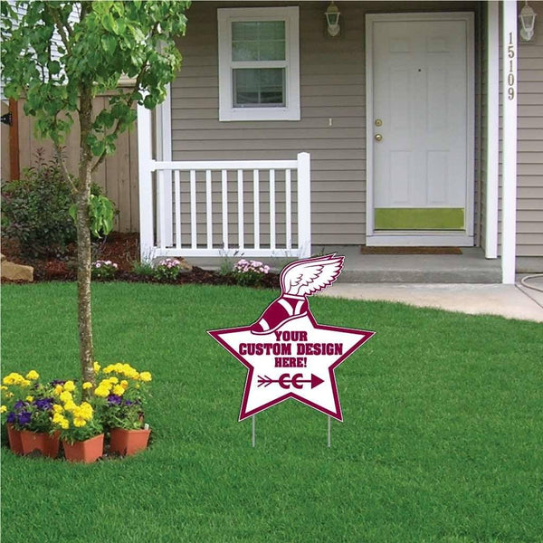 A star shaped yard sign in the front of a house