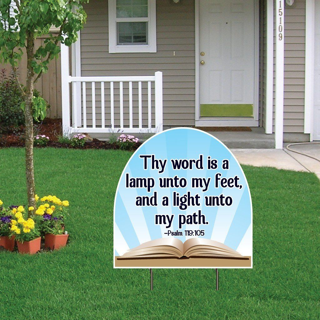 "A yard sign that says ""Thy word is a lamp unto my feet, and a light unto my path."""