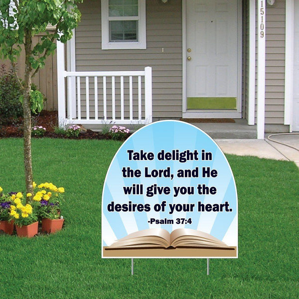 "A yard sign that says ""Take delight in the Lord, and he will give you the desires of your heart."""