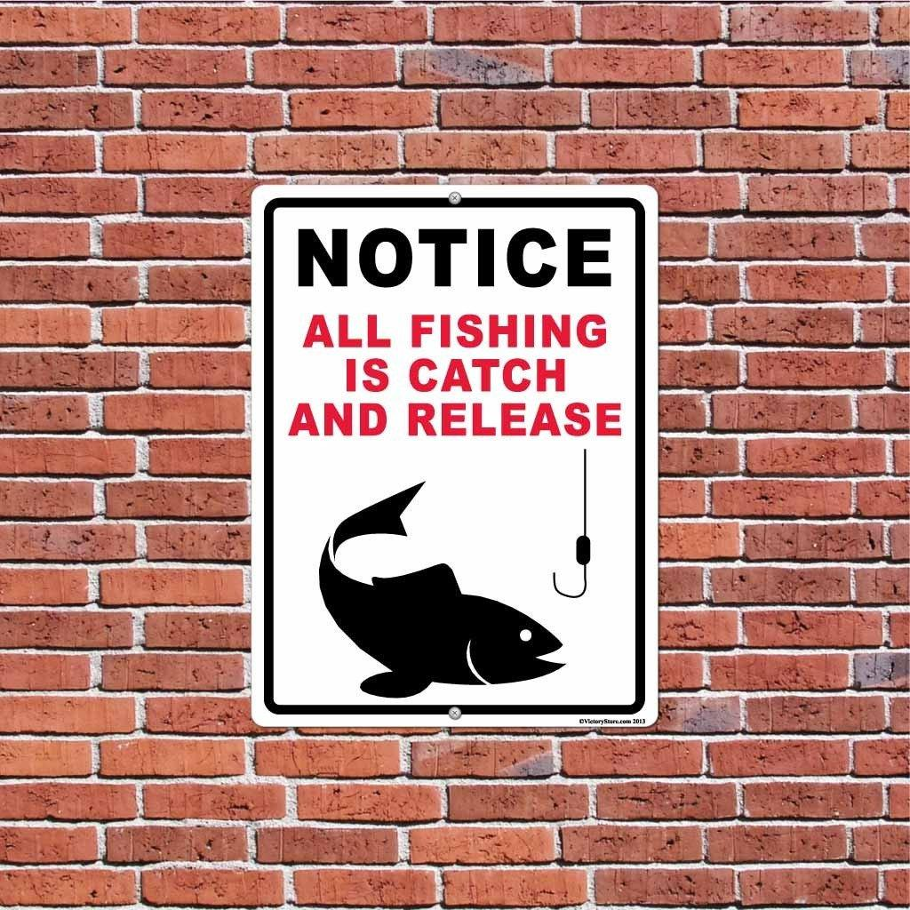 "A aluminum sign on a brick wall that says ""Notice, All fishing is catch and release"""