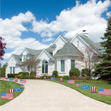 House with patriotic yard signs