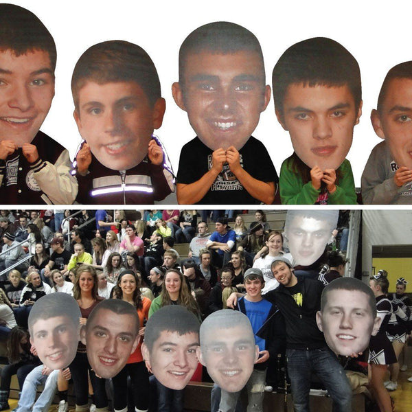 Several big head student cut outs made of corrugated plastic
