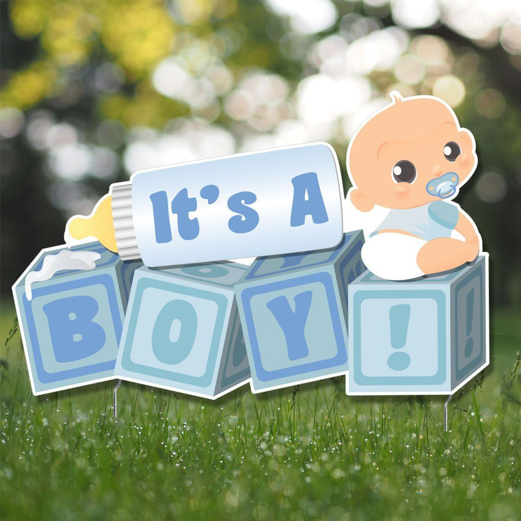 "A sign that says ""It's a boy!"""