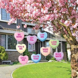 The front yard of a house with Candy Heart Valentine's Decorations hanging from a tree