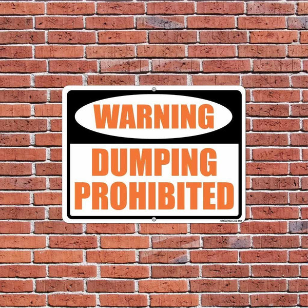 "An aluminum sign that says ""Dumping Prohibited"""