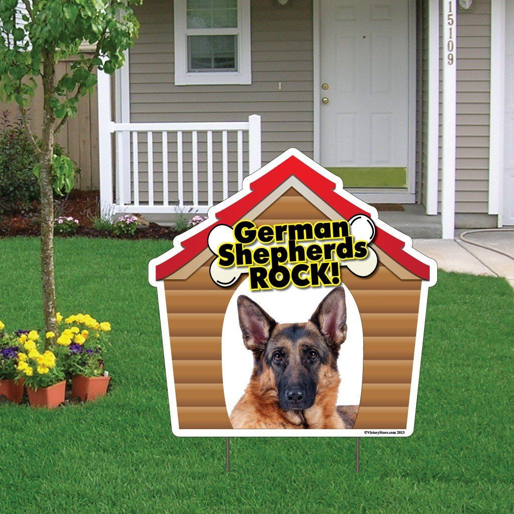 A yard sign with a dog on it