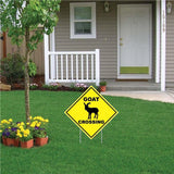 "A yard sign that says ""Goat Crossing"""