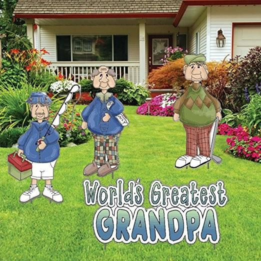 The front yard of a house with a sign that says Worlds Greatest Grandpa