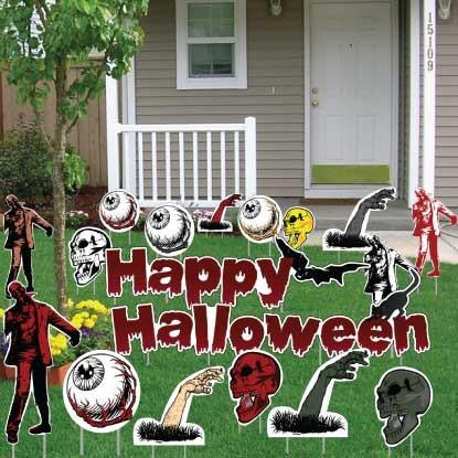 The front yard of a house with Halloween yard sign decorations