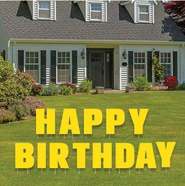 The Front Yard Of A House That Says Happy Birthday Decorations