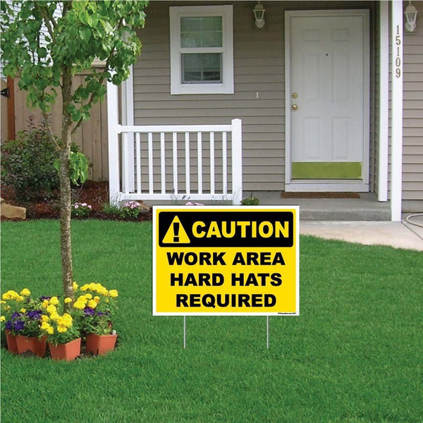 "A yard sign that says ""Caution, Work Area Hard Hats Required"""