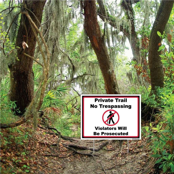 "A yard sign that says ""Private trail, no trespassing. Violators will be prosecuted"""