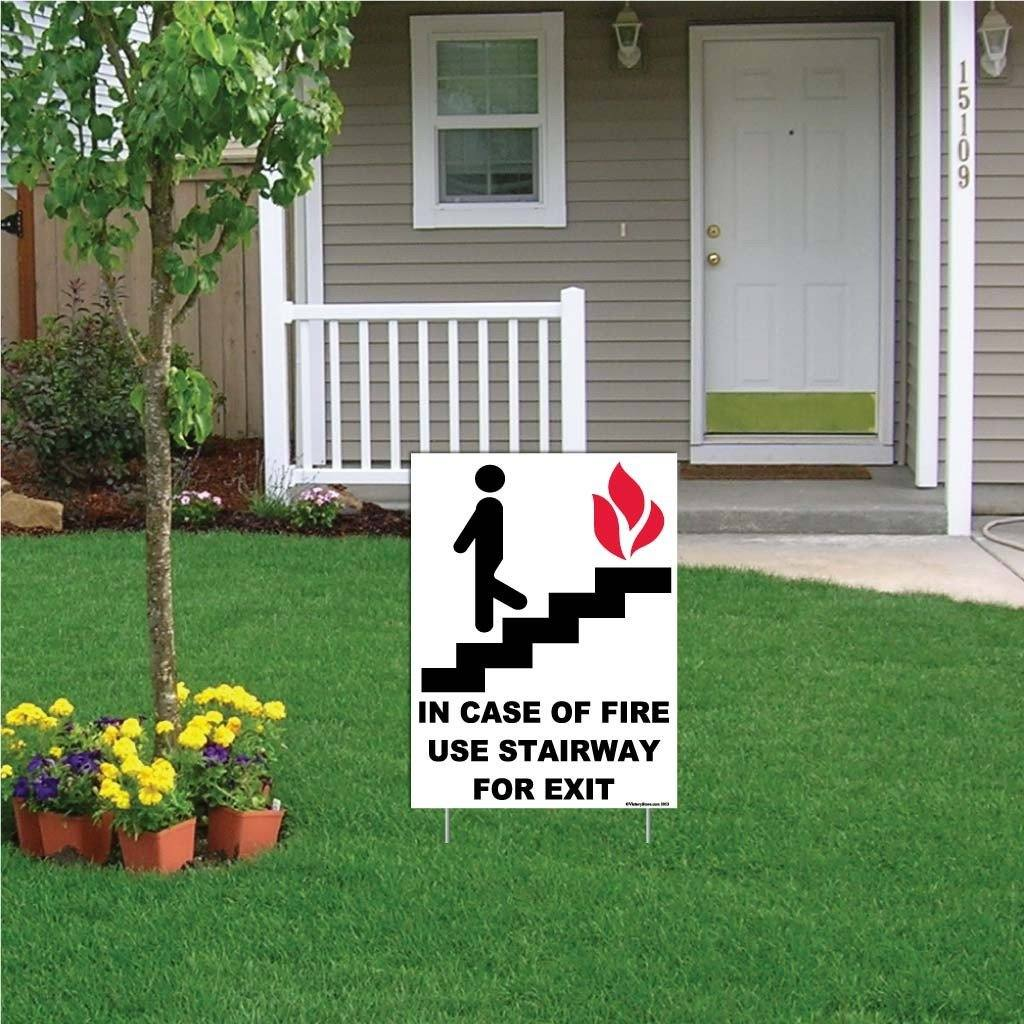 A yard sign for a fire exit