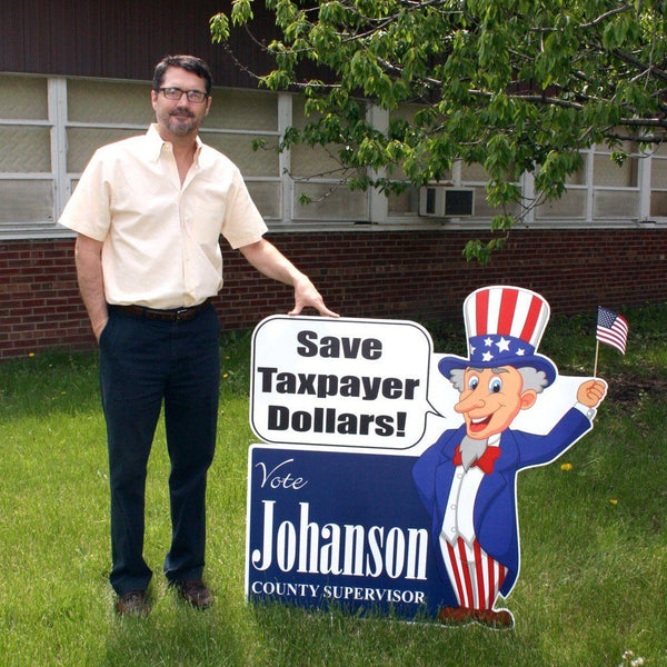 A man standing next to a yard sign