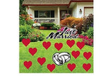 The front yard of a house with several red hearts Valentine's Day Decoration