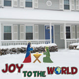 "The front yard of a house with a nativity scene and signs that say ""Joy to the World"""