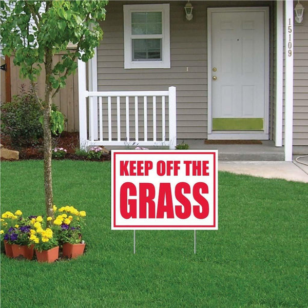 "A yard sign that says ""Keep off the grass"""