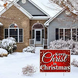 "The front yard of a house with a sign that says ""Keep Christ in Christmas"""