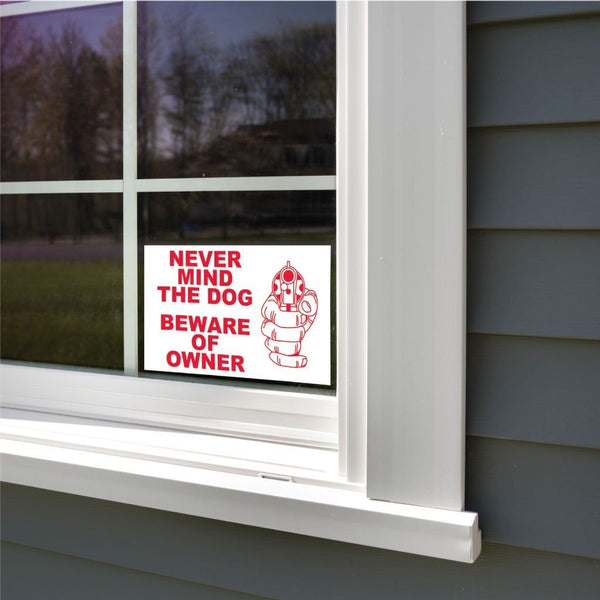 A beware of owner sticker sign on a window