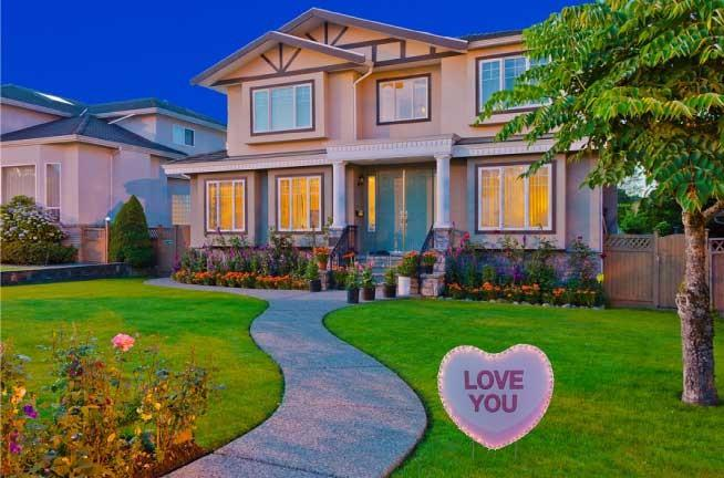 "The front yard of a house with a sign that says ""Love You"""