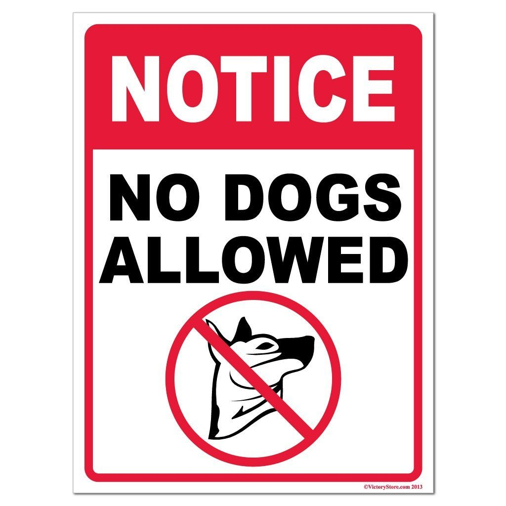 A yard sign that says no dogs allowed