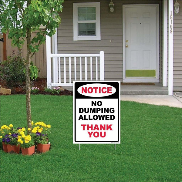 "A yard sign that says ""Notice, no dumping allowed, thank you"""