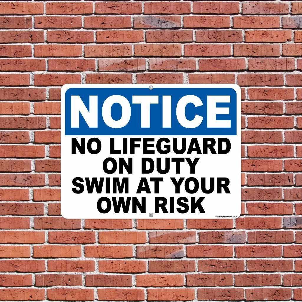 "An aluminum sign that says ""No lifeguard no duty"""