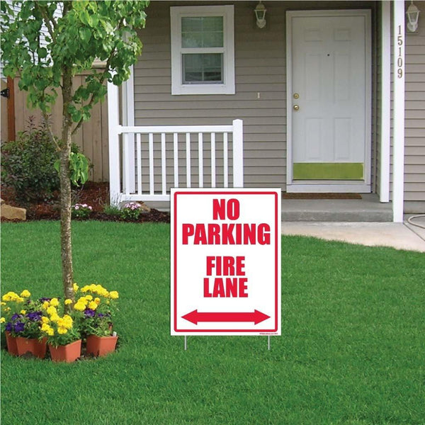 "A yard sign that says ""No parking, Fire Lane"""