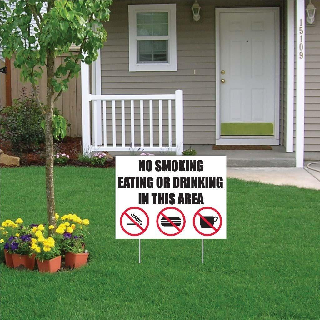 "A yard sign that says ""No smoking eating or drinking in this area"""