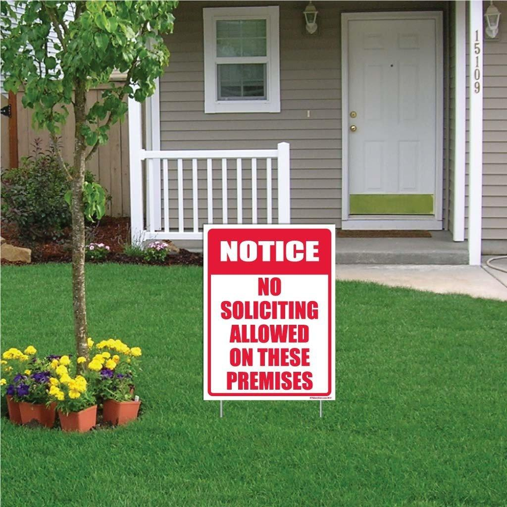 "A yard sign that says ""Notice, no soliciting allowed on these premises"""