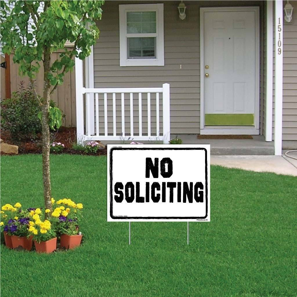"A yard sign that says ""No soliciting"""