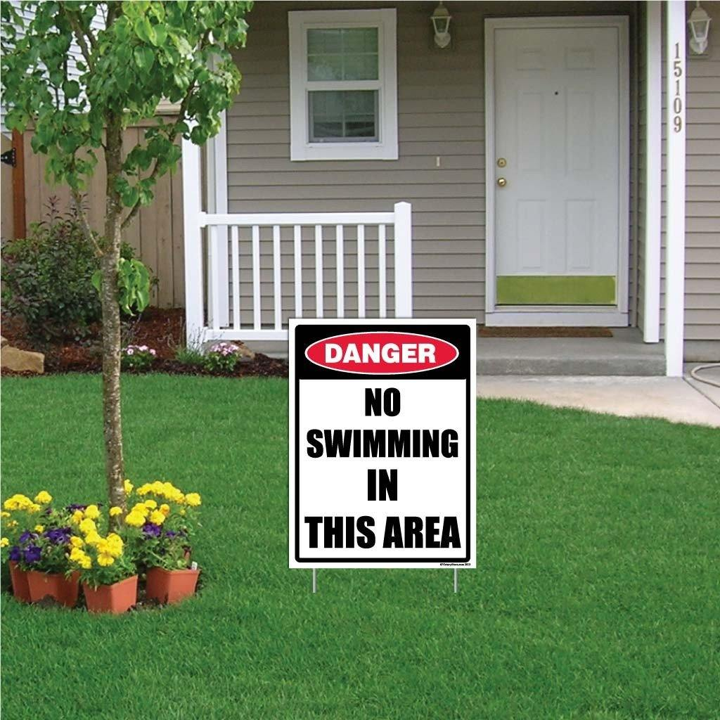 "A yard sign that says ""No Swimming in this area"""