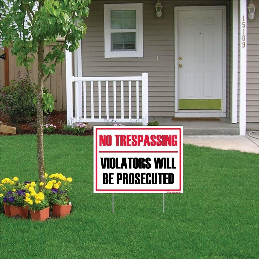 "A yard sign that says ""No Trespassing, violators will be prosecuted"""