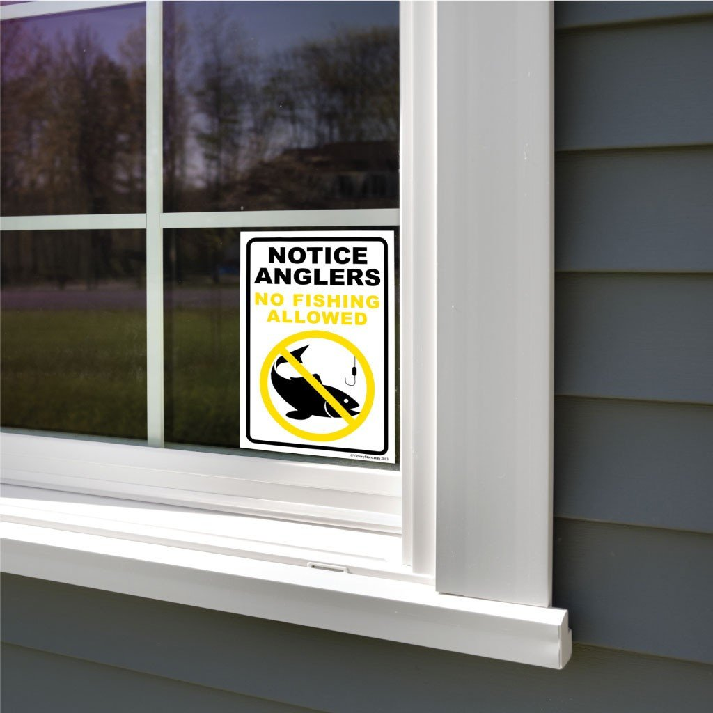 A yard sign on a window
