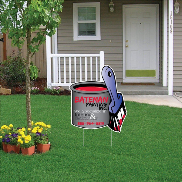 A paint can shaped yard sign