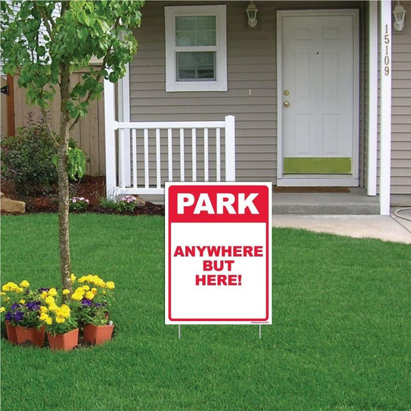 "A yard sign that says ""Park Anywhere but here!"""