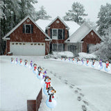 A driveway lined with snowmen Christmas yard Decorations