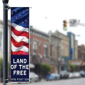 A patiotic banner attached to a pole