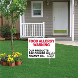 "A yard sign that says ""Food Allergy Warning, Our products are cooked in peanut oil"""