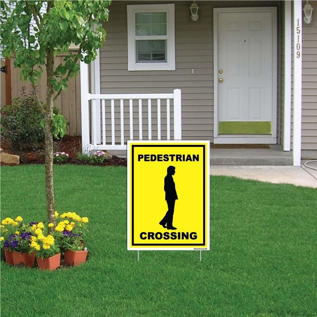 "A yard sign that says ""Pedestrian Crossing"""