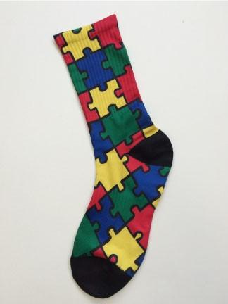 A puzzle piece themed sock