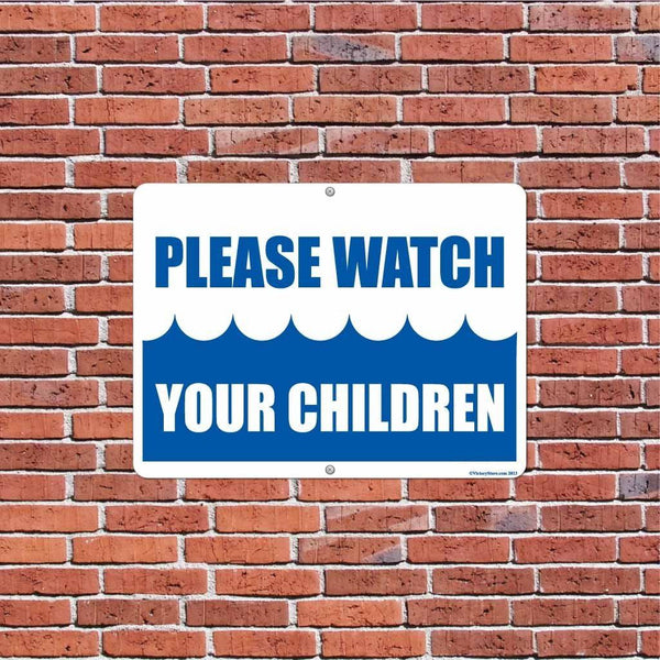 A yard sign on a brick wall